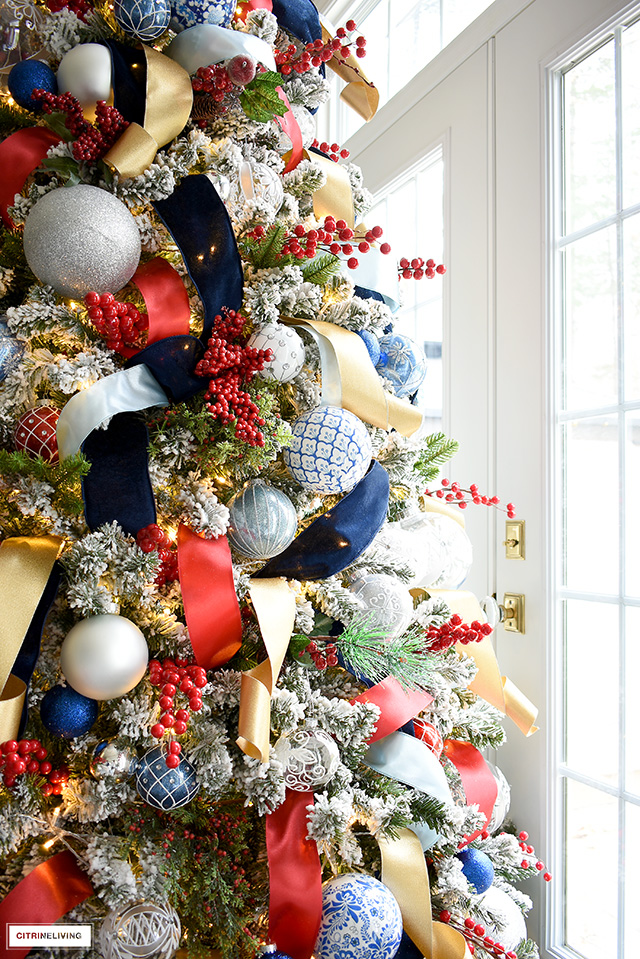Christmas tree trimmed in red, navy, lighter blues, gold and silver is classic and elegant!