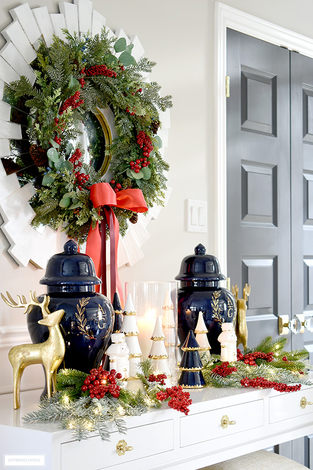 Christmas decorating with ginger jars, ceramic trees, reindeer, nutcrackers and holiday greenery withered berries.