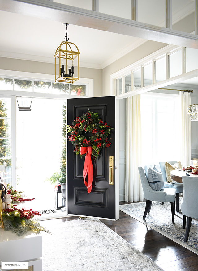Christmas entryway and dining room decorating, beautiful front door with full, lush holiday wreath is festive and welcoming!