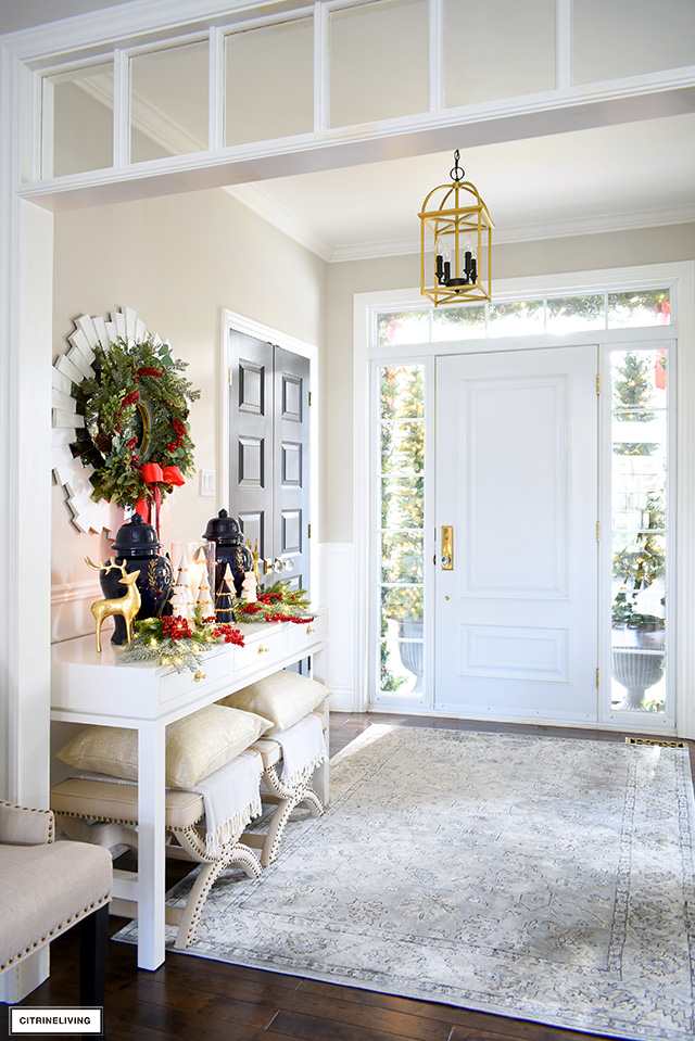 Christmas decorating in the entryway - console table with a beautify holiday vignette.