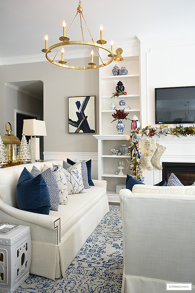 Christmas living room decor with blue and white chinoiserie and red accents.