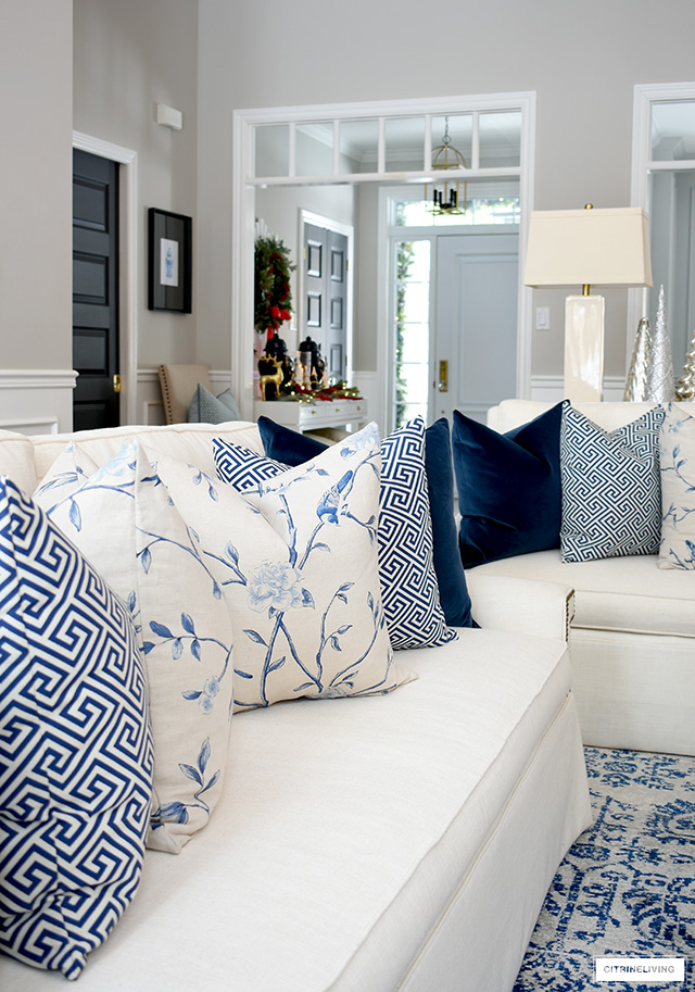 Beautiful throw pillows in blue and white floral, greek key and solid navy velvet.