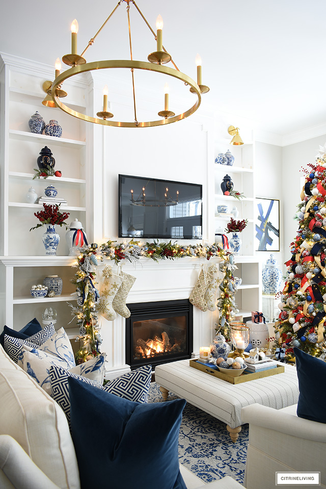 Christmas living room with blue and white chinoiserie accented with red.