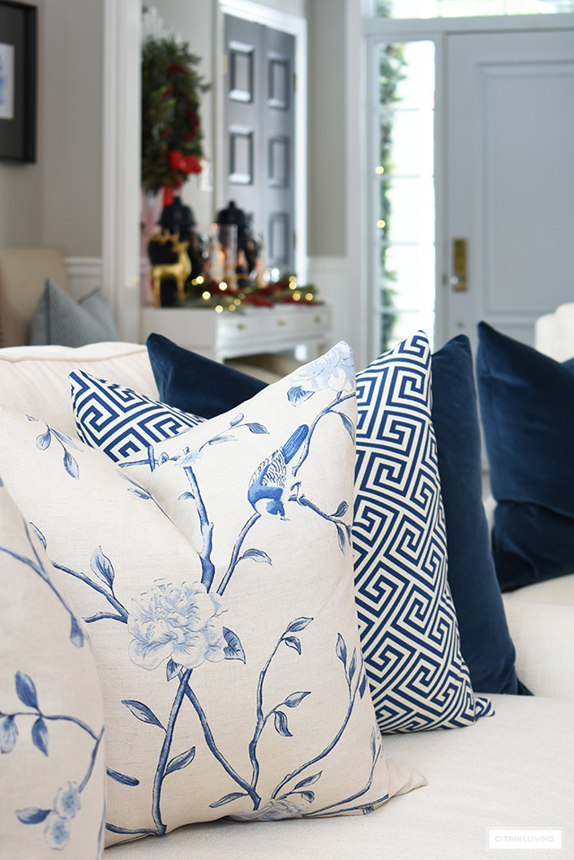 Luxe Chinoiserie floral throw pillow in blue and white.