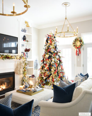 Living room decorated for Christmas in blue, red and gold.