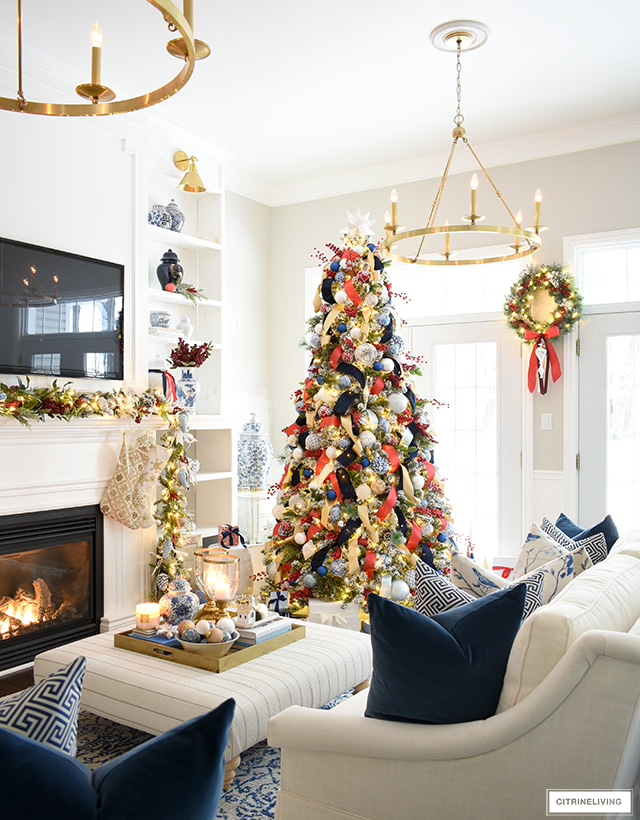 Christmas living room decor with blue and white and red accents.
