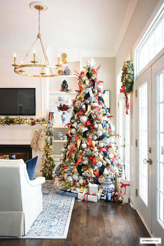 Christmas tree decorated in blue, red, white and gold.