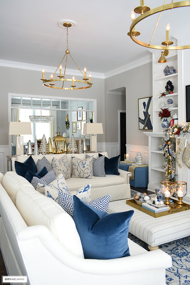 Christmas living room with white sofas and beautiful blue chinoiserie pillows.