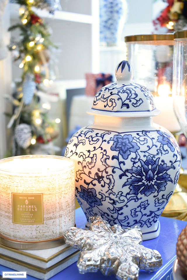 Blue and white ginger jar, Christmas ornament and scented candle.