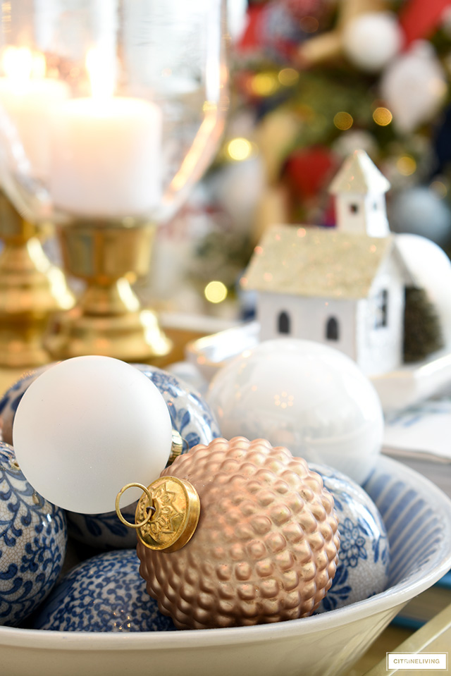 Christmas ornaments styled with blue and white balls.