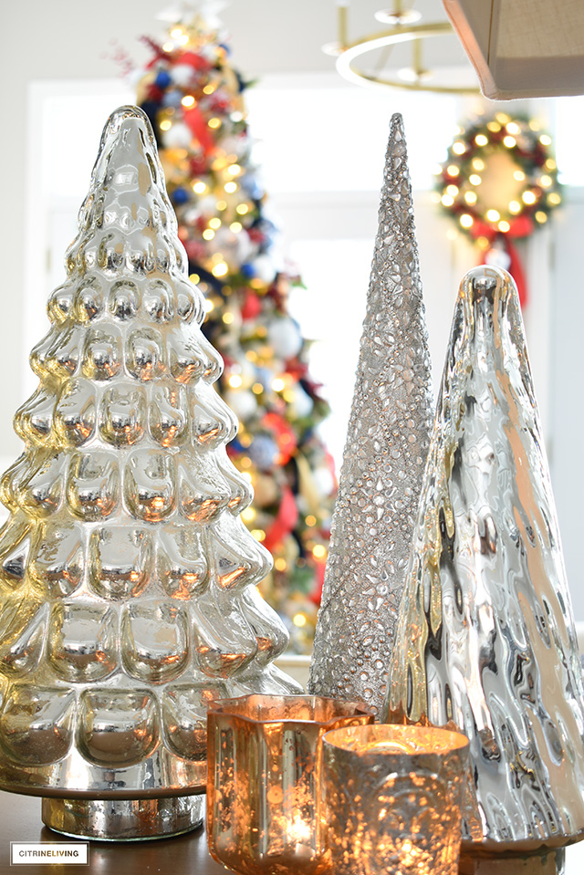 Mercury glass Christmas trees and candles.
