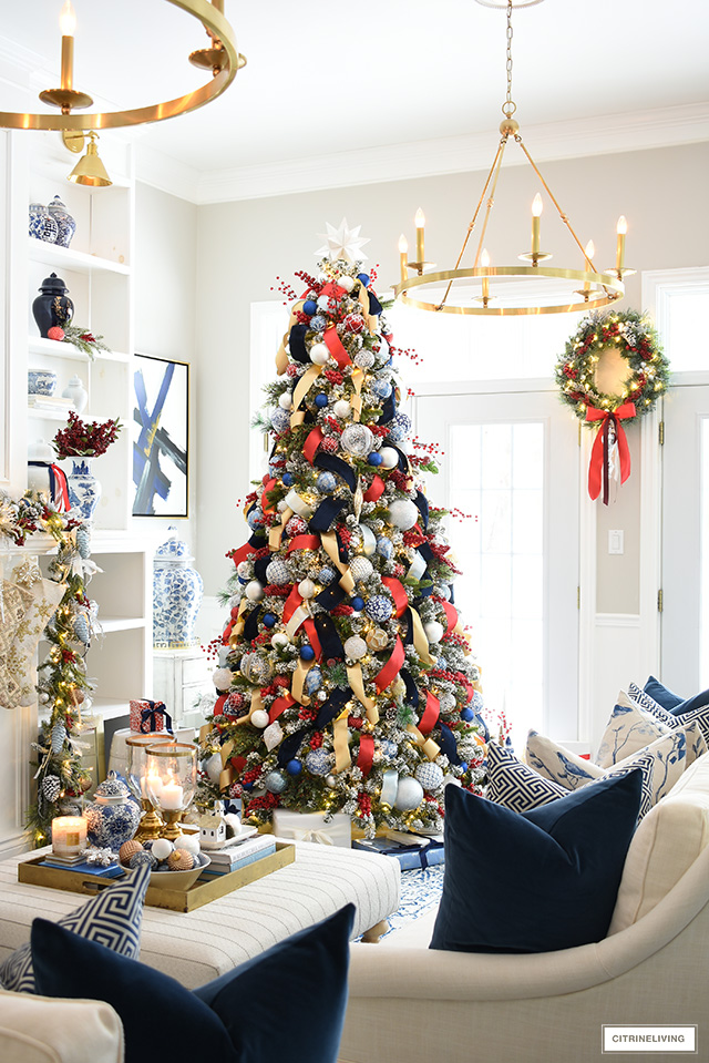 Christmas living room decorated in red, white, blue and gold.