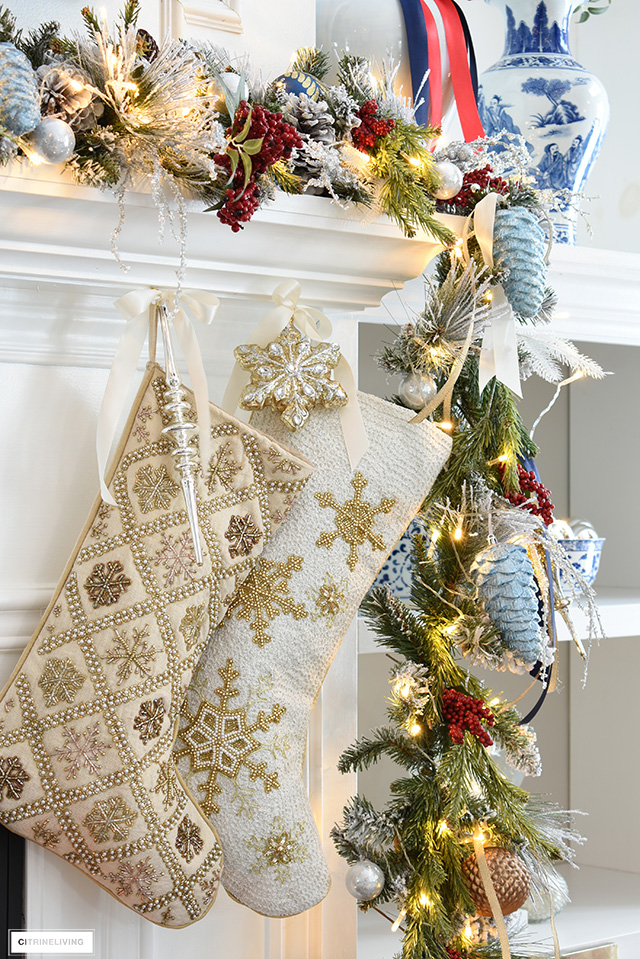 Christmas mantel with decorated garland and beaded stockings.