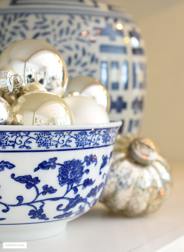 Ornaments styled in a blue and white bowl.