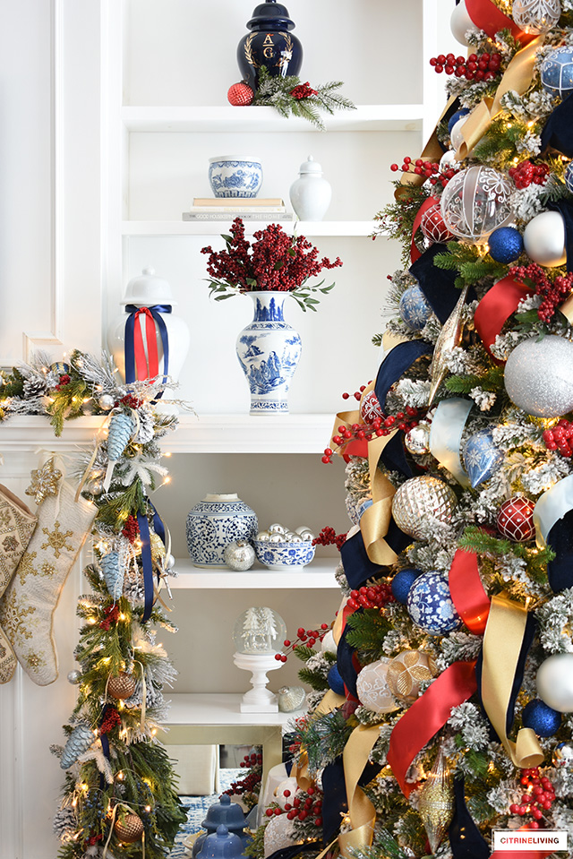 Christmas decorated shelves with ginger jars, vases red berries, pine and ornaments.