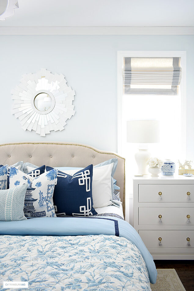 Beautiful bedroom decorated for spring in blue and white chinoiserie.