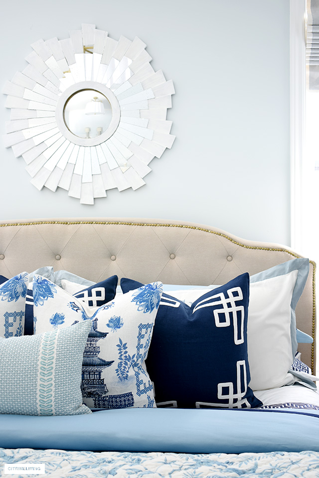 Layers of beautiful blue and white chinoiserie throw pillows are the perfect accent for spring.