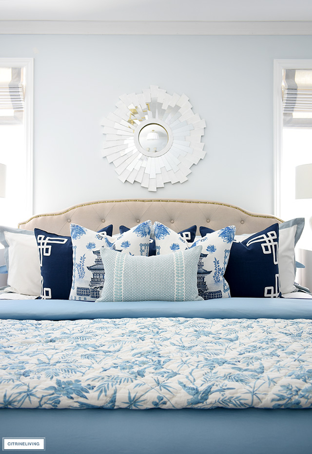 Beautiful spring bedding in layers of chinoiserie blue and white.