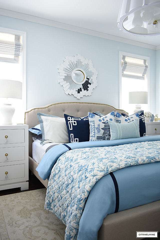 Elegant master bedroom decorated with blue and white chinoiserie chic for spring.