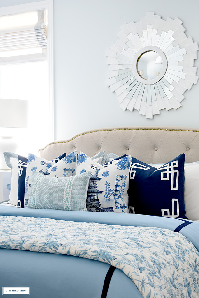 Layers of chinoiserie blue and white pillows is the perfect addition for a spring bedroom refresh!