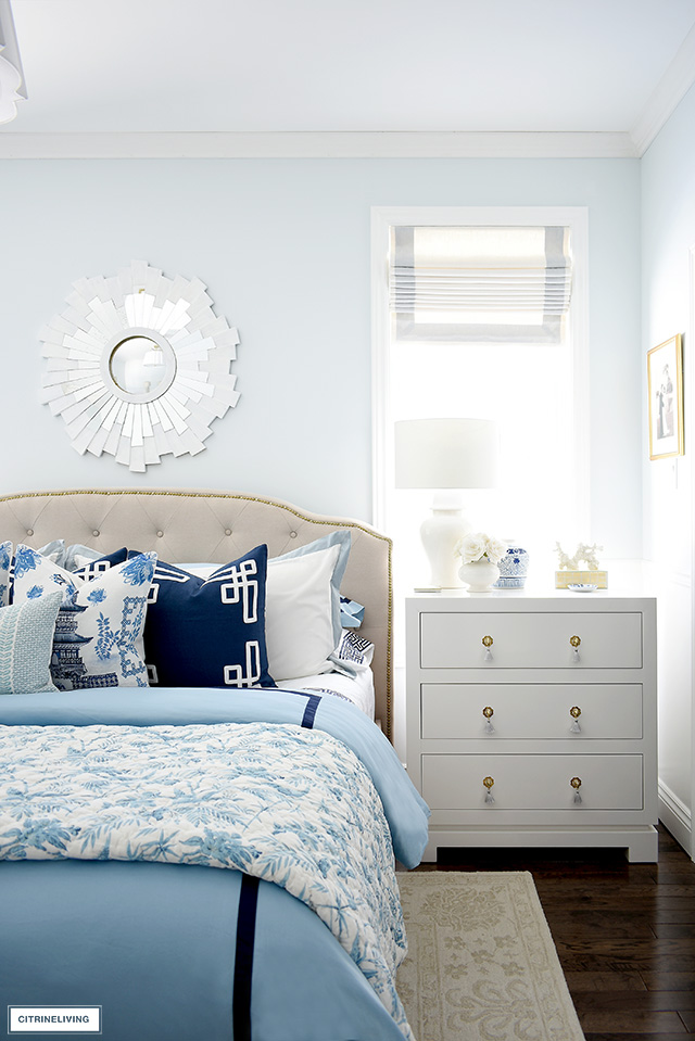 Chic bedroom decorating for spring with layers of blue and white chinoiserie.