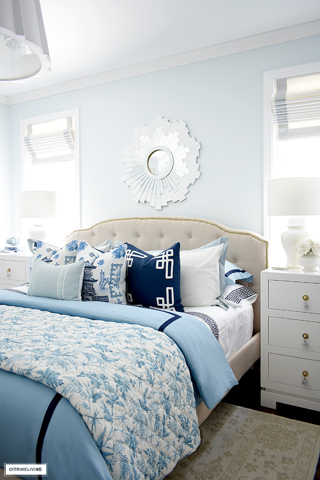 Gorgeous and luxe bed styled with blue and white chinoiserie style bedding and pillows
