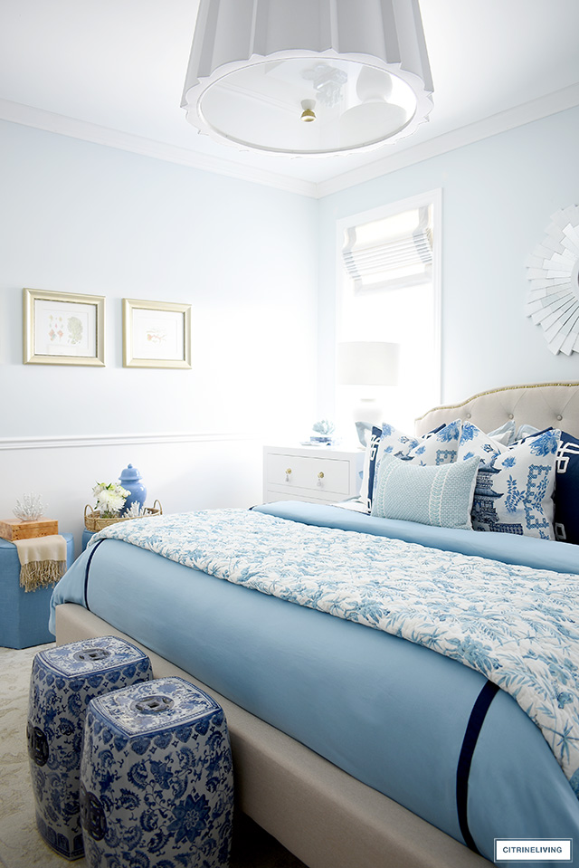 Master bedroom decor layered in blue and white chinoiserie for spring.