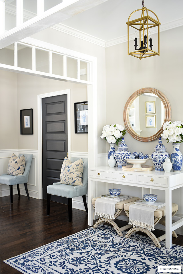 A gorgeous spring decorated entryway with blue and white chinoiserie, wood accents and pretty white peonies.