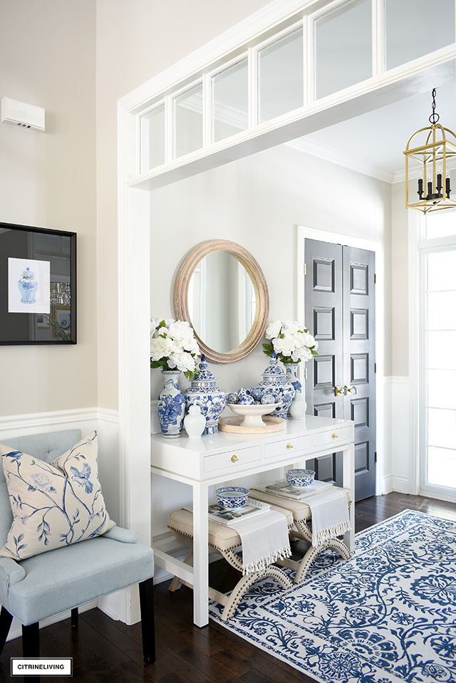 Blue and white chinoiserie details styled in a bright and chic spring entryway.