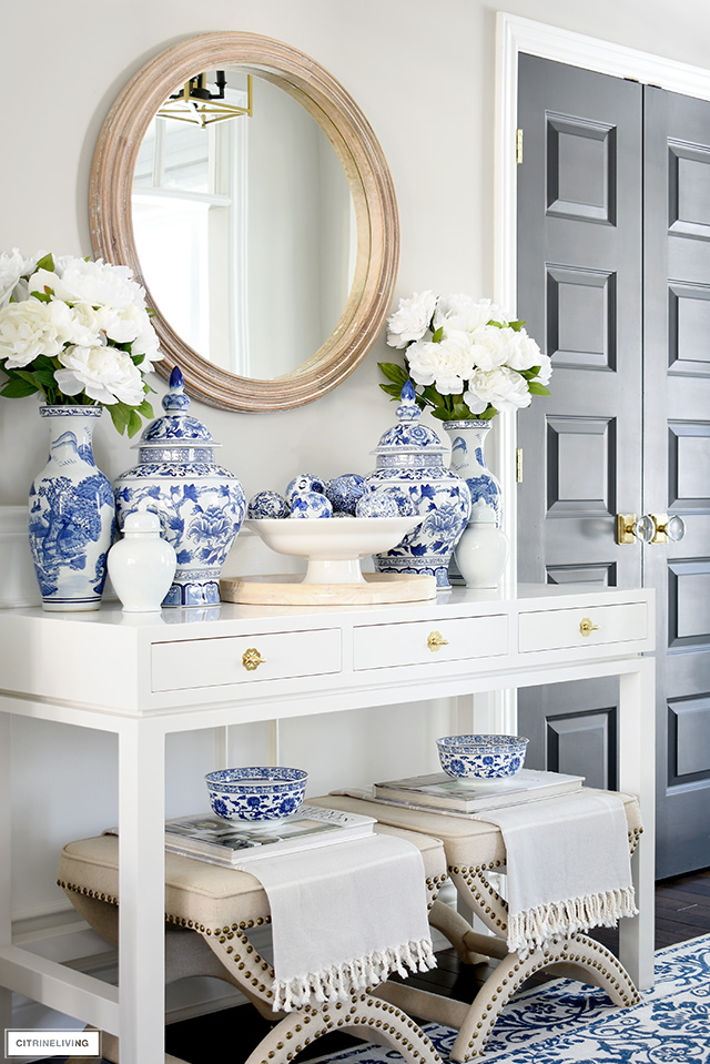 Spring entryway decorated with blue and white, faux florals and wood accents.