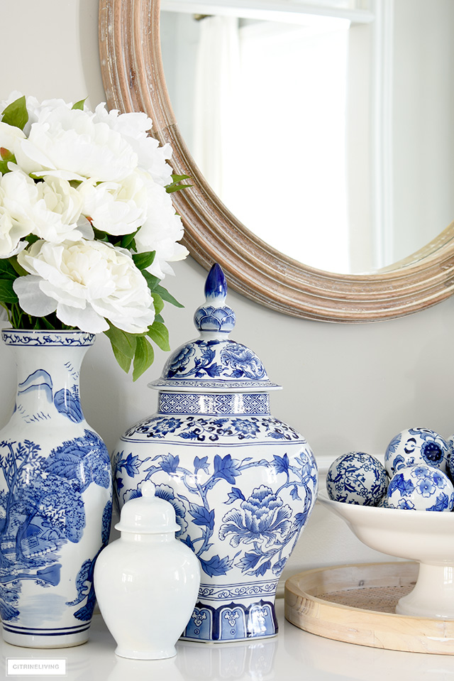 Blue and white ginger jar, vase and faux florals create a pretty spring-styled display.