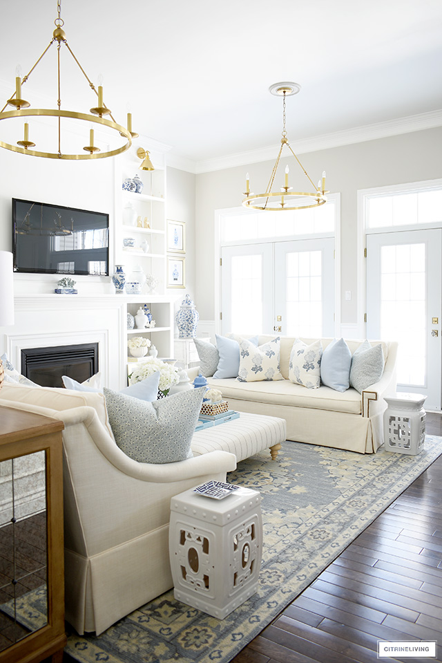 Spring living room decor with soft blues, creamy whites, coastal accents and a few natural touches.