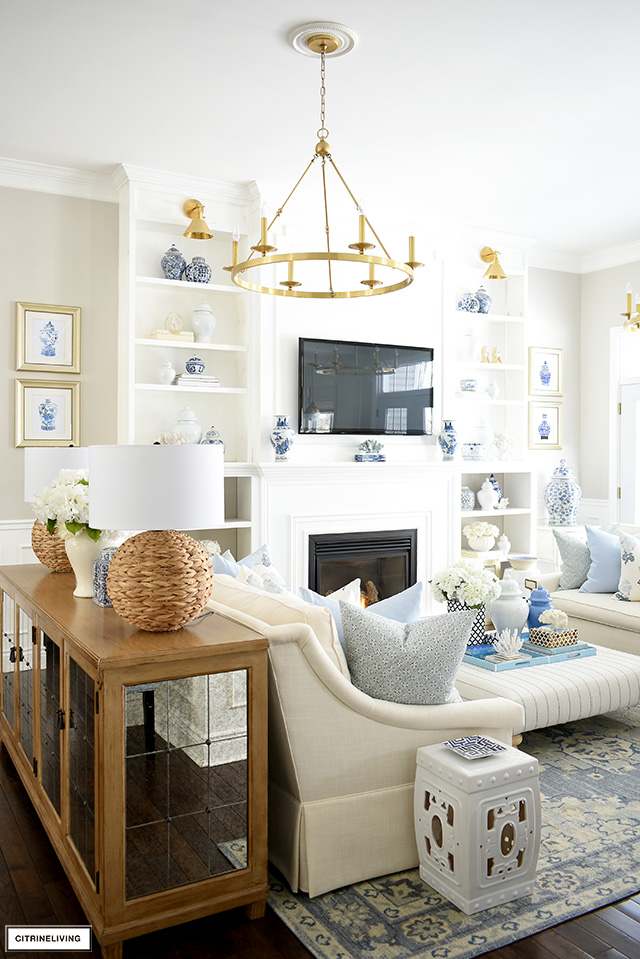 Casual and chic living room decor with soft blue and white, natural touches, coastal accents and chinoiserie ginger jars and art.
