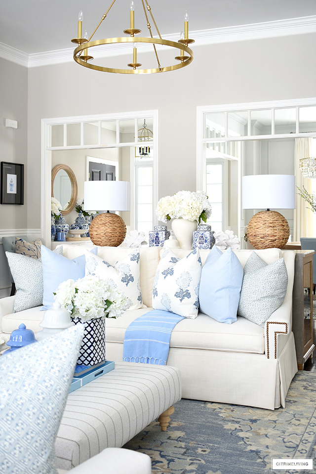 Elegant spring living room decor with beautiful light blue and white, wood and natural touches, chinoiserie and coastal touches.