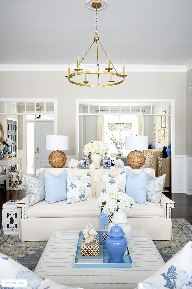 Living room decor for spring with light blue, warm white, natural elements, coastal accents and chinoiserie.