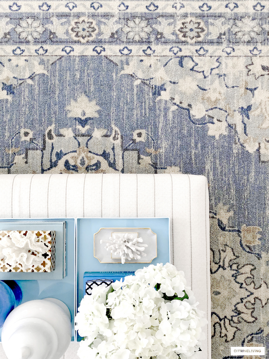 Beautiful living room rug in a soft blue and beige tribal pattern.