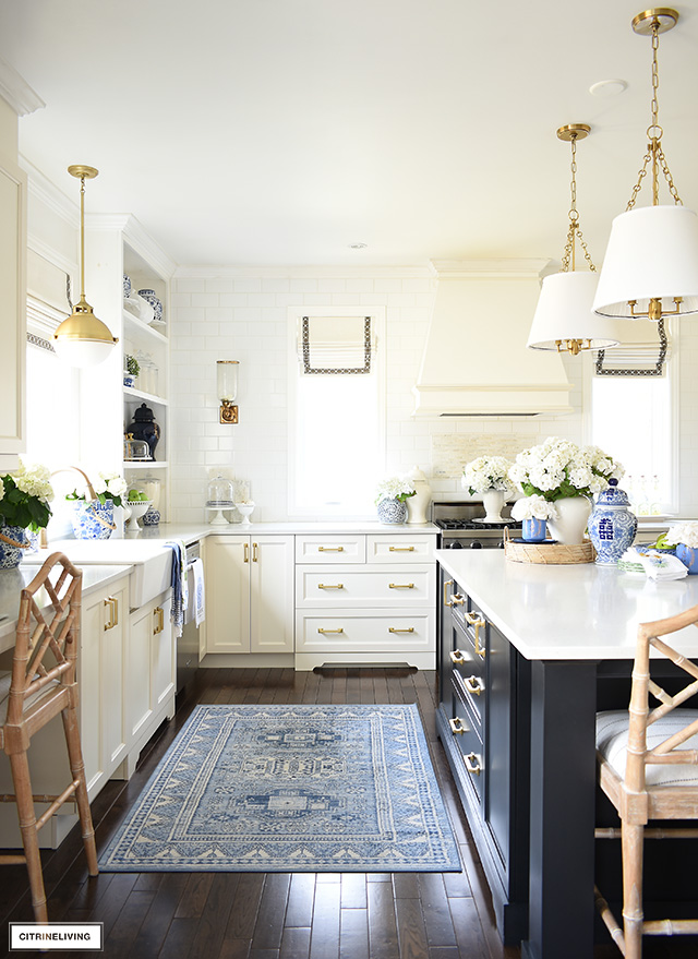 Beautiful kitchen decorated for spring with blue and white chinoiserie accents and faux flowers.