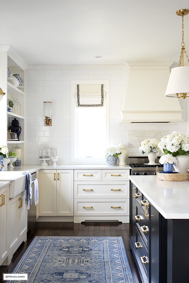 Spring kitchen decor with blue and white accents and faux flowers.