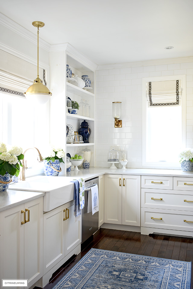 Spring decorated kitchen with blue and white chinoiserie accents and hydrangeas.