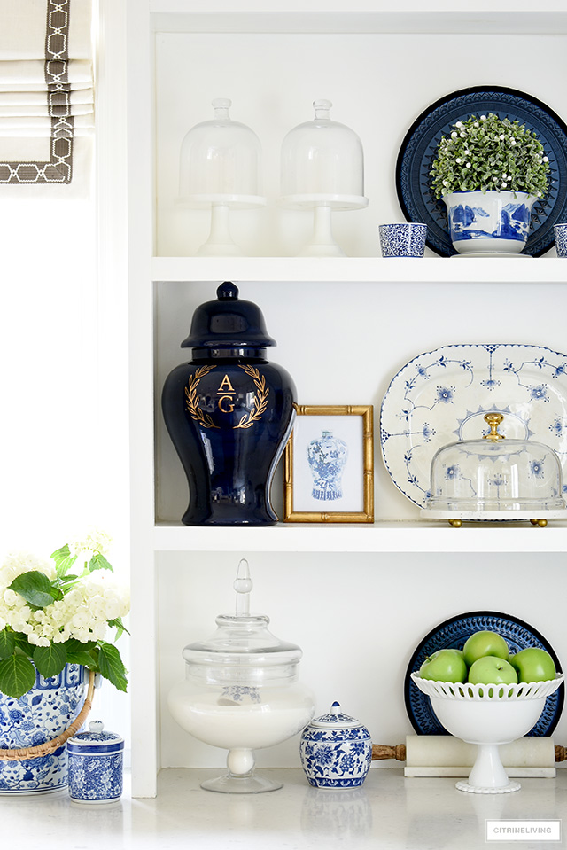 Blue and white accents styled on kitchen shelves for spring.