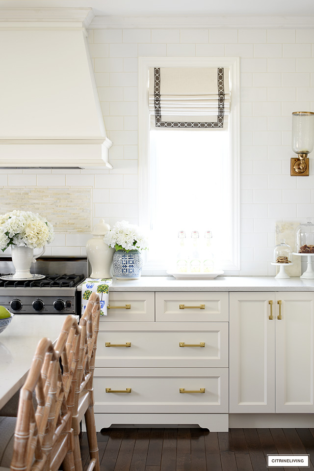 Spring kitchen decor with blue and white chinoiserie and faux florals.