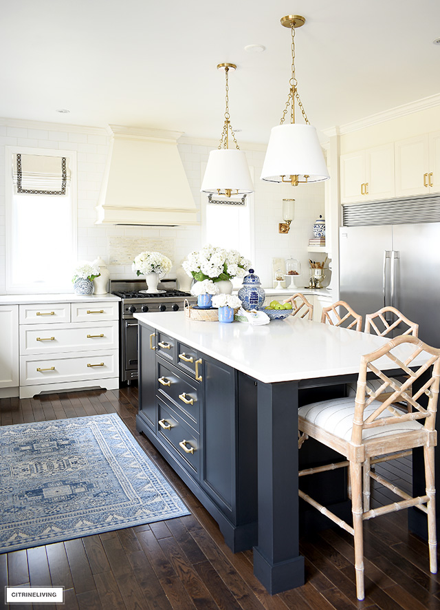 Spring decorated kitchen with chinoiserie touches in blue and white and faux florals.