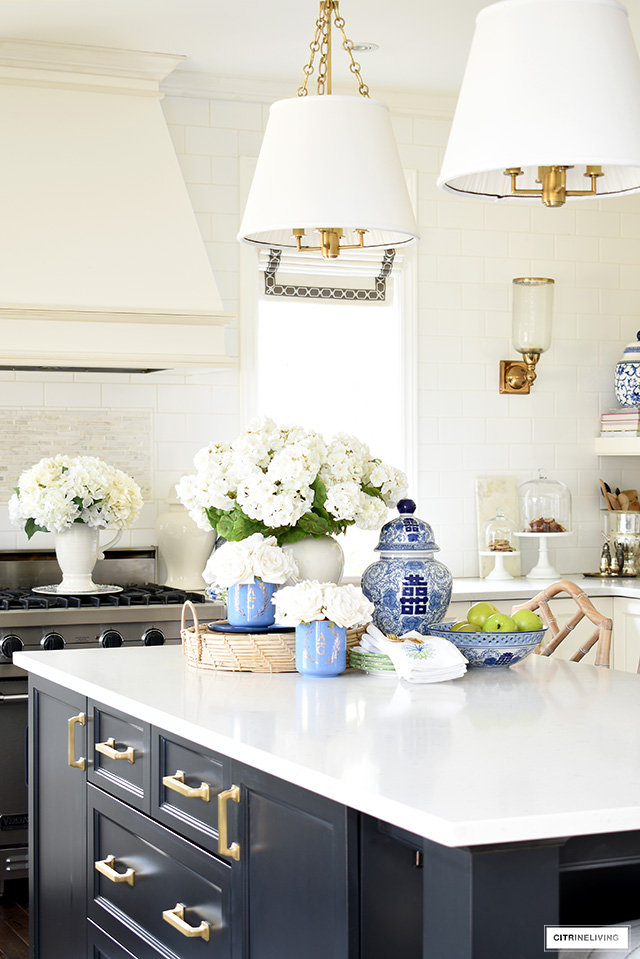Spring decorated kitchen island with blue and white ginger jars and faux florals.