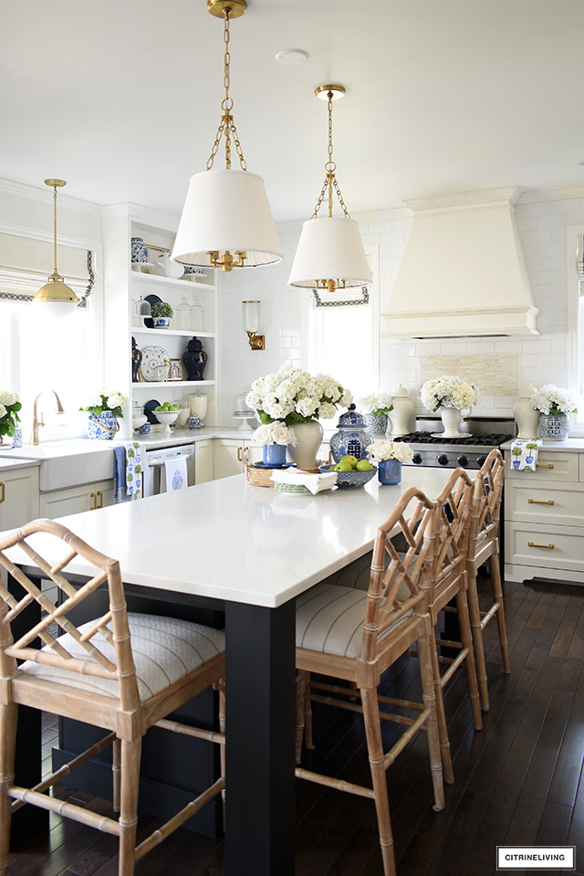 Spring kitchen decorating with florals, blue and white, ginger jars and greenery.