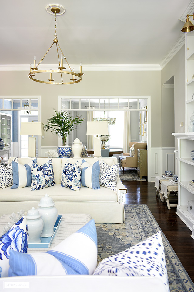 Living room decor for summer in blue and white, chinoiserie and palms.