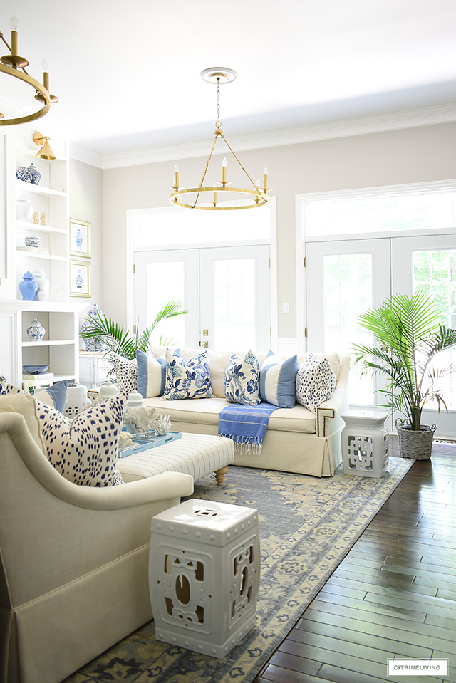 Beautiful living room decorated for summer in a blue and white coastal, Hamptons look.