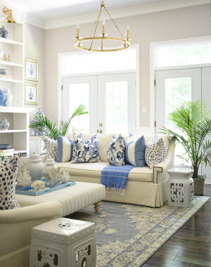 Summer living room decor with blue and white Hamptons-inspired pillows.