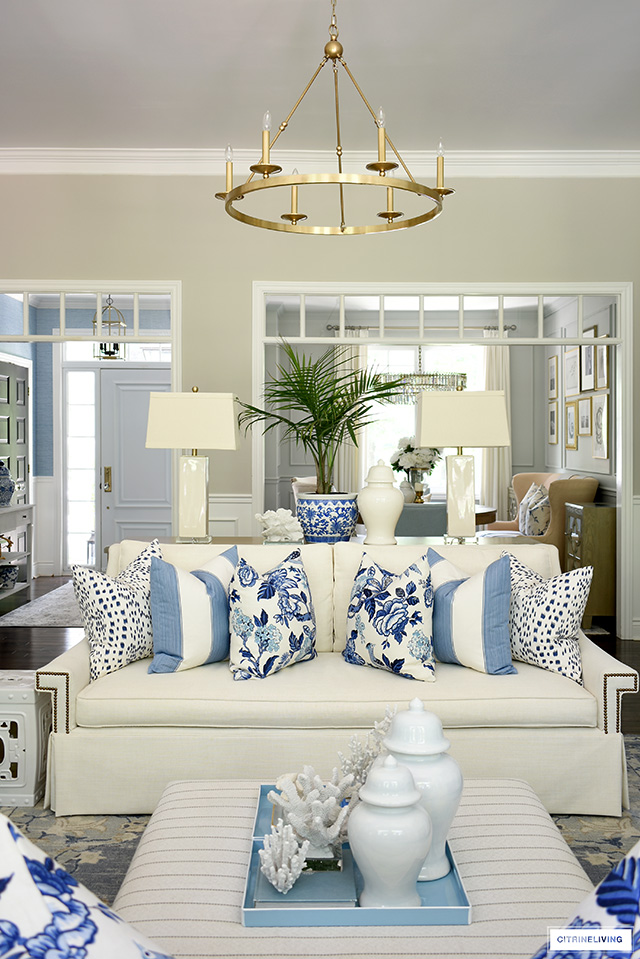 Beautiful summer decorating with blue and white hamptons-style pillows and decor.