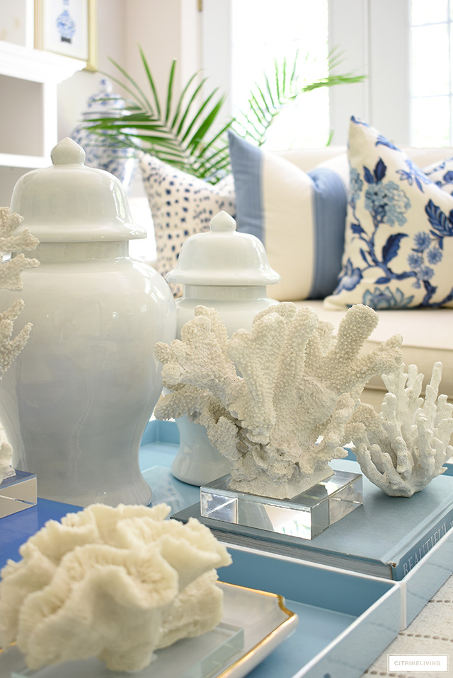 A beautiful collection of coral sculptures styled with ginger jars on a tray.