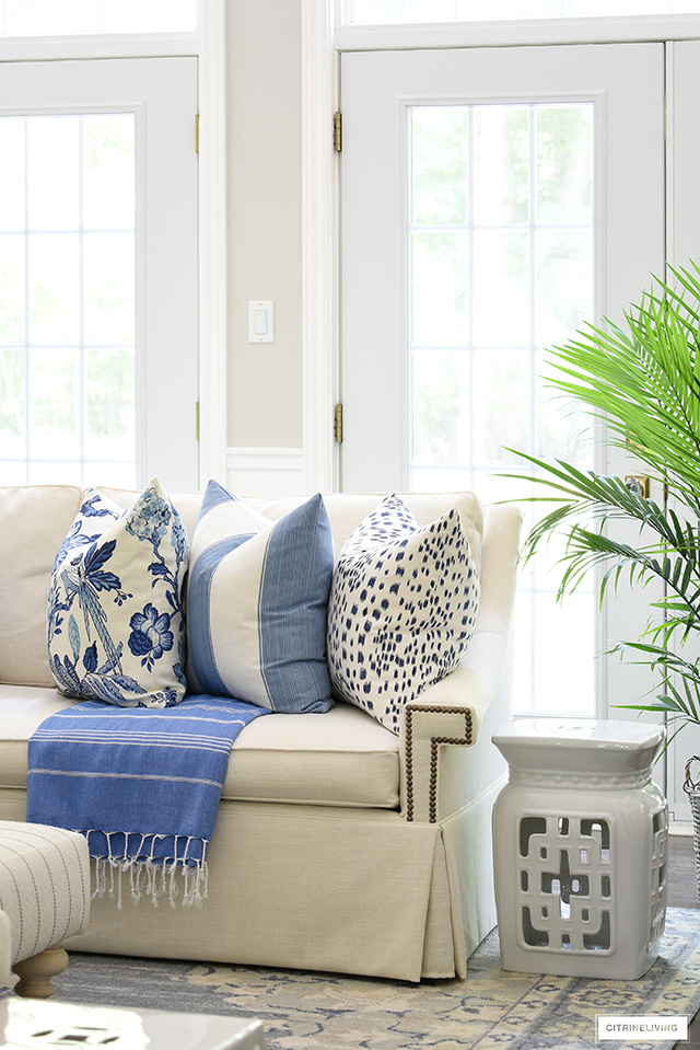 Blue and white pillows styled for summer!